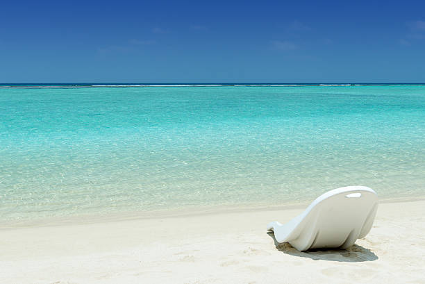 chair on a tropical beach stock photo
