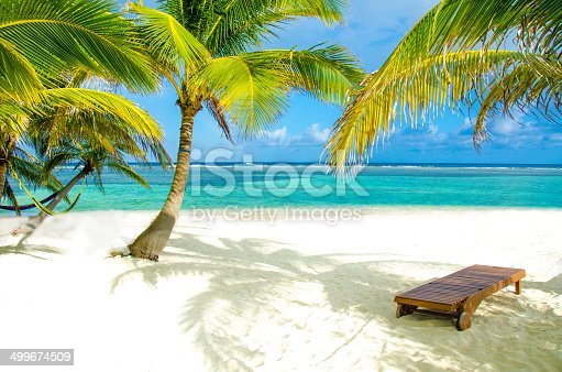 White beach on beautiful island with lounger / chair