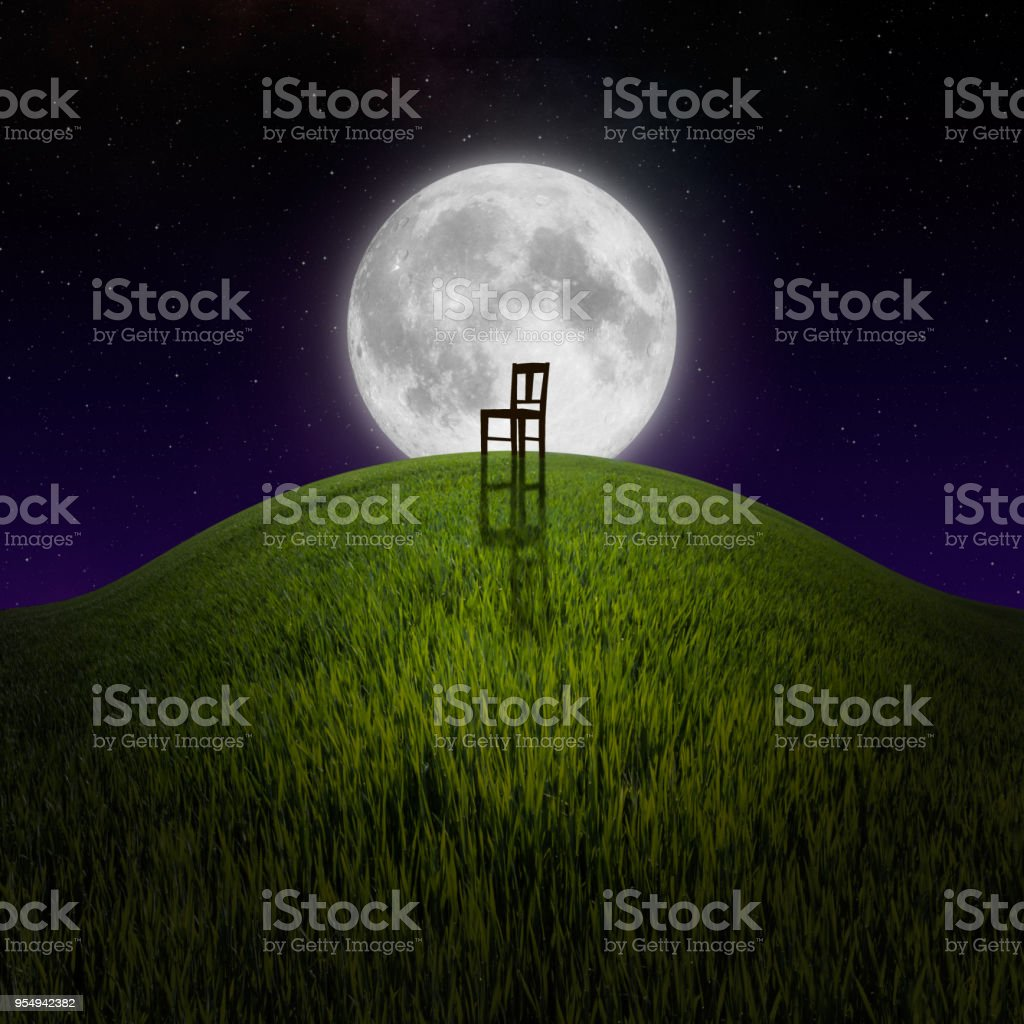 Chair on night hill lit by moon stock photo