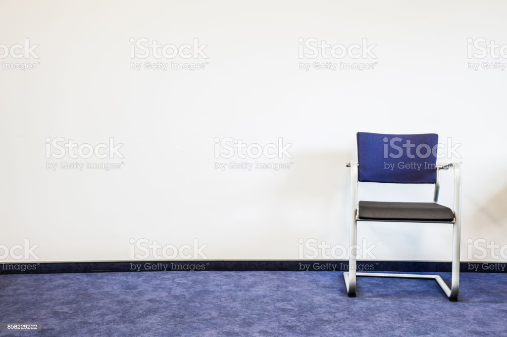 Chair On The Blue Carpet Floor At The Wall Waiting Room In Office Hospital Clinic Education Or Other Institution Place For Waiting Of Job Interview Interior Concept Empty Place For Text Stock