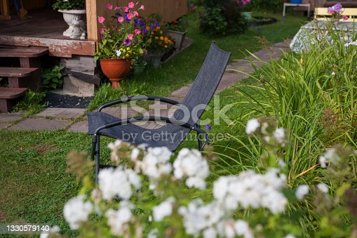 istock chair placed outside a summerhouse 1330579140