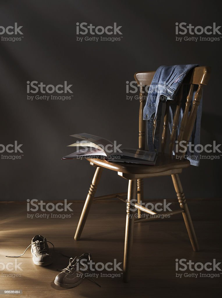 Chair, shoes and book royalty-free stock photo
