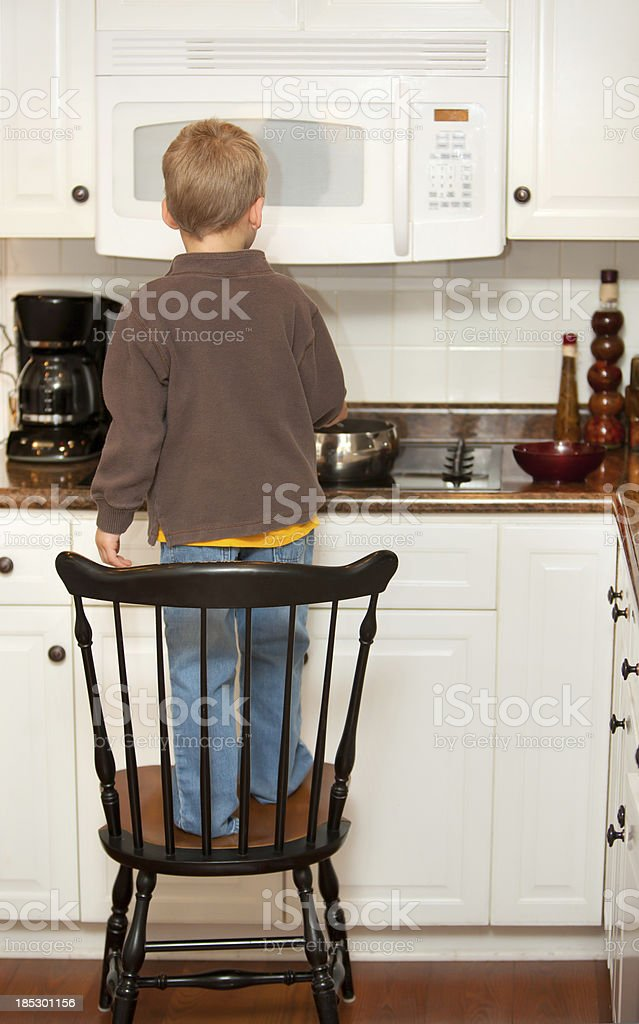 chair standing boy stock photo