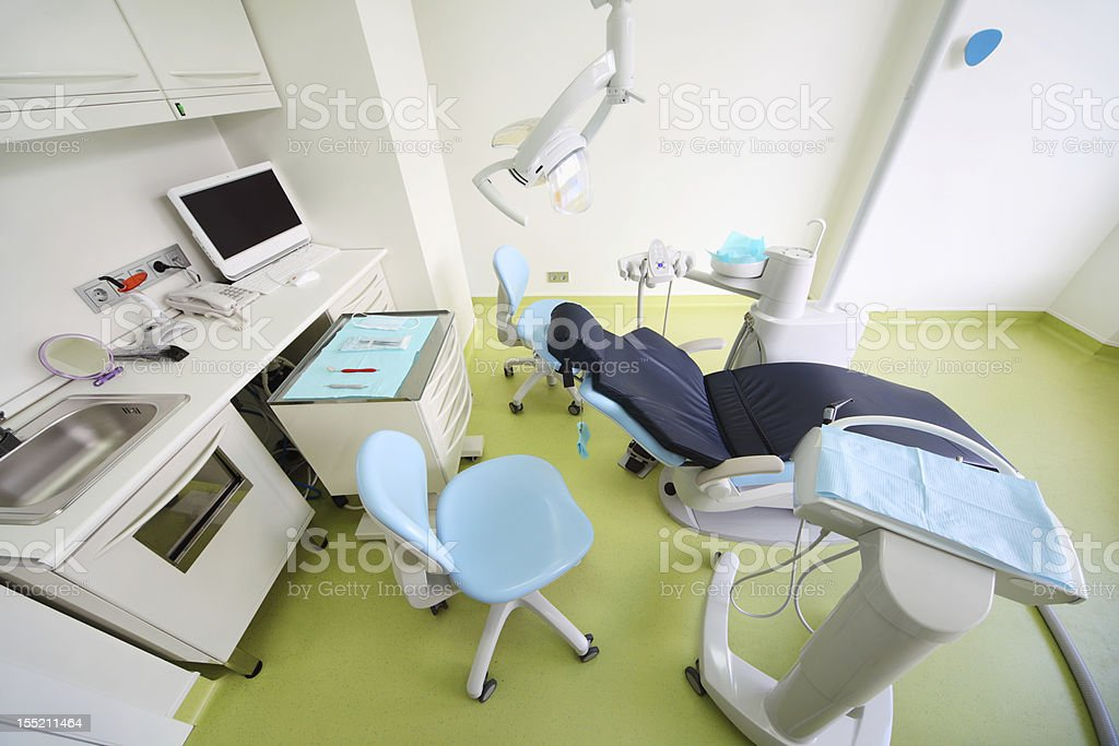 Chair, table with tools, computer and drill for dentist royalty-free stock photo