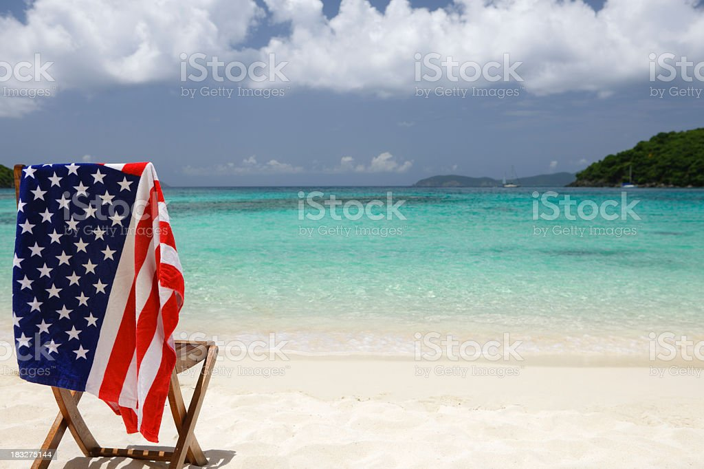 chair with american flag at a US Virgin Islands beach stock photo