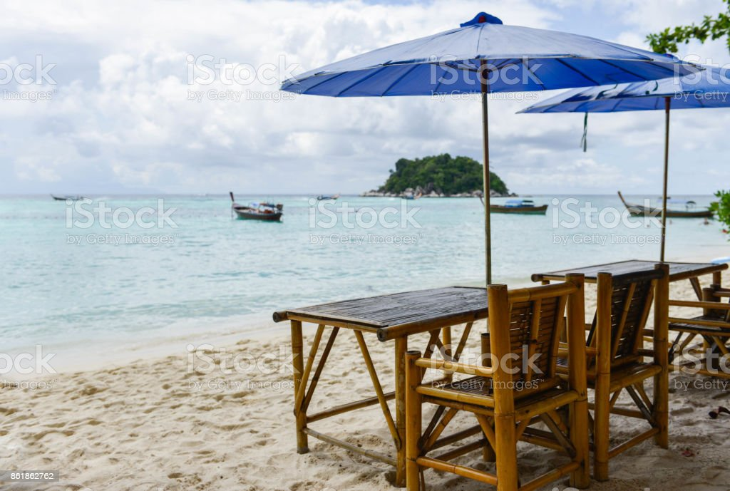 Chair with umbrella are on the beach stock photo
