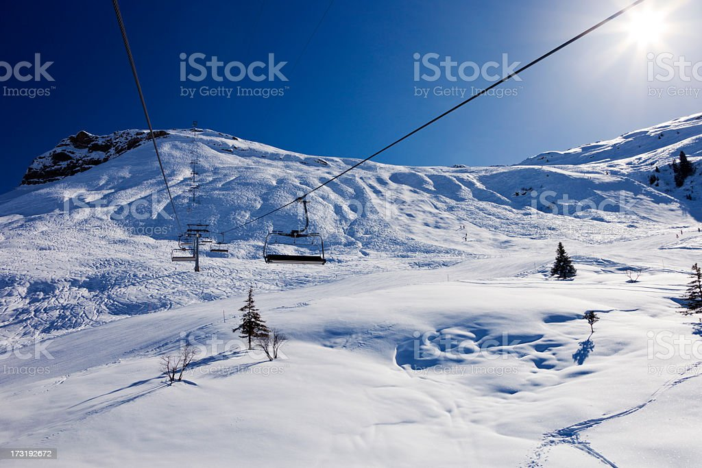 Chairlift and Slopes in Obersaxen royalty-free stock photo