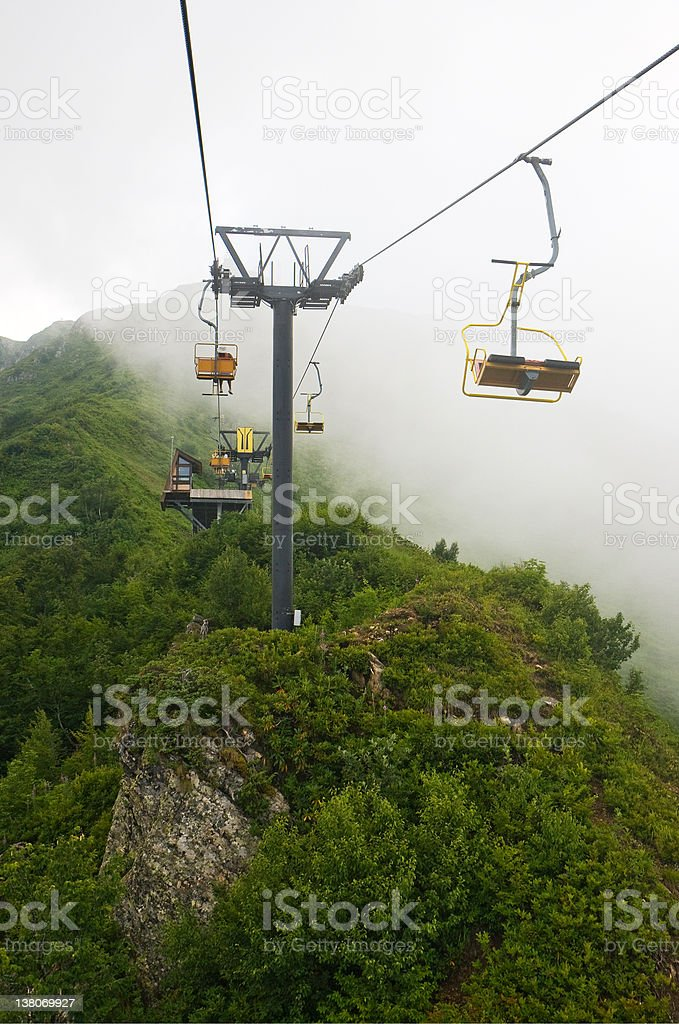 Chairlift in the fog royalty-free stock photo