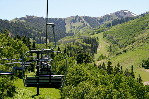 A chairlift in the mountains during the summer