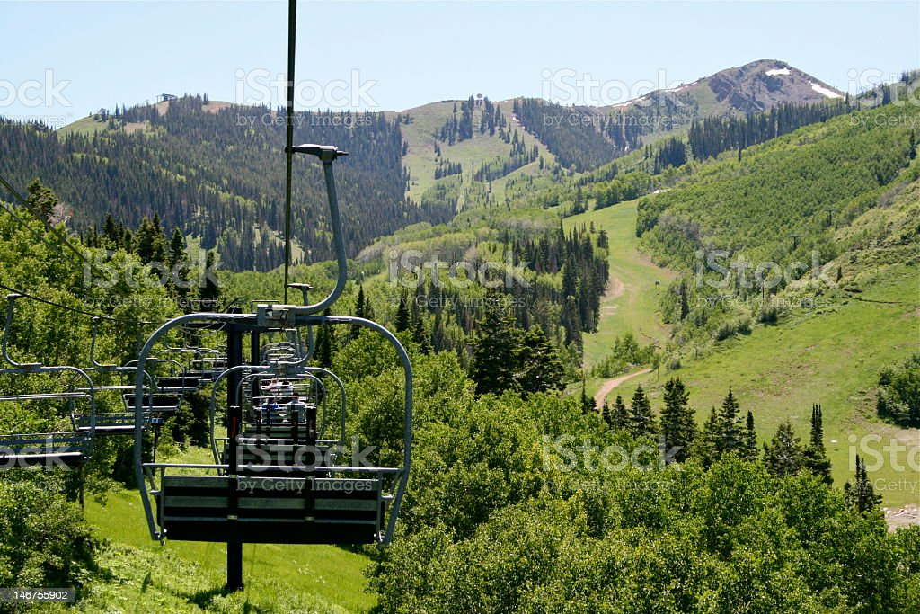 A chairlift in the mountains during the summer stock photo