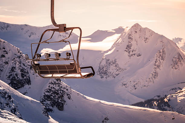 Chairlift with majestic mountain background. stock photo