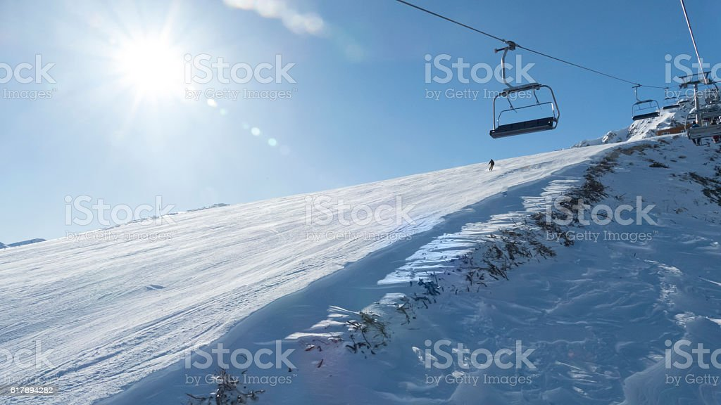 Chairlifts and ski slope in ski resort, low angle view stock photo