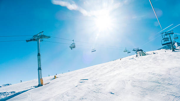 Chairlifts in ski resort, low angle view stock photo