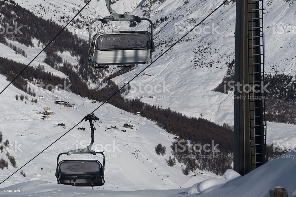 Chairlifts with ski slopes royalty-free stock photo