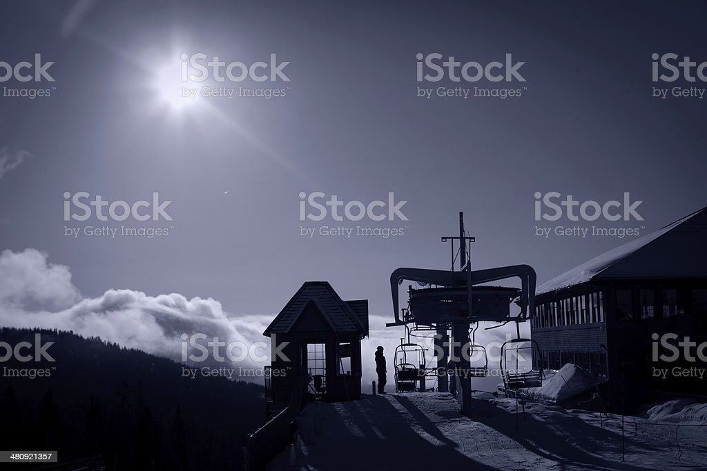 Chairlit at sunrise above the clouds. stock photo