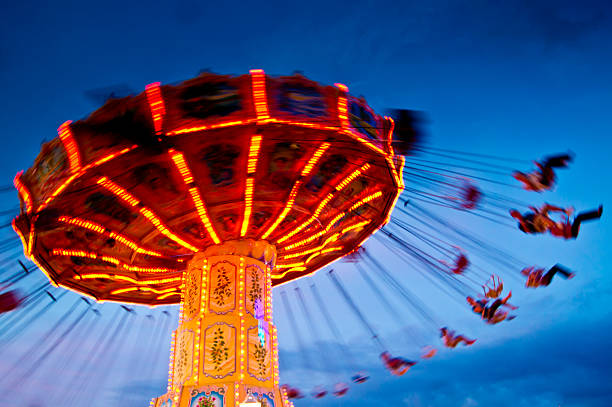 chairoplane at blue hour/sunset - school fete stock photos and pictures