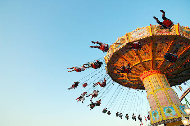 chairoplane a carousel in action traveling carnival stock pictures, royalty-free photos & images