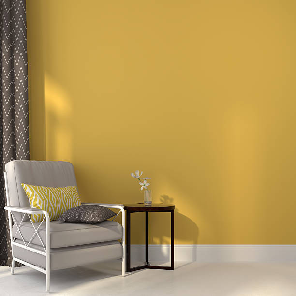 Chairs and a table on yellow background stock photo