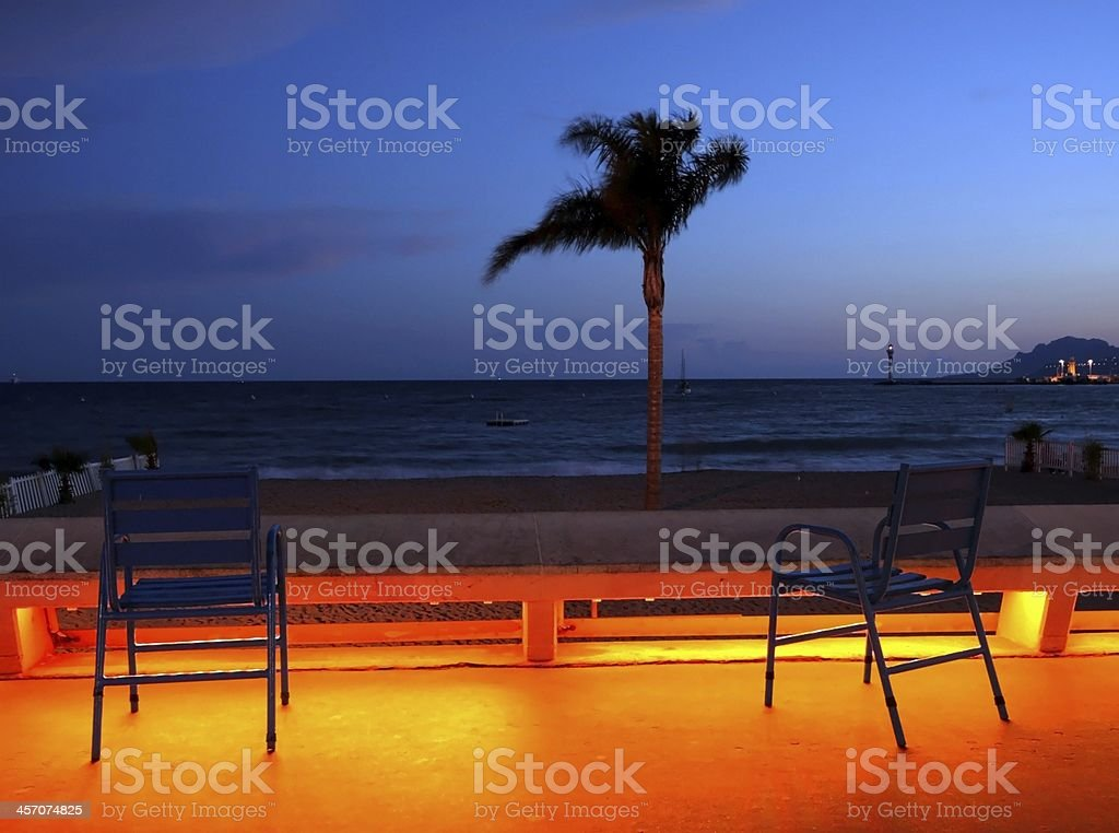 chairs and beach sunset stock photo