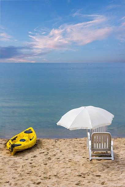 Chairs and canoe on the beach. Dream beach vacation