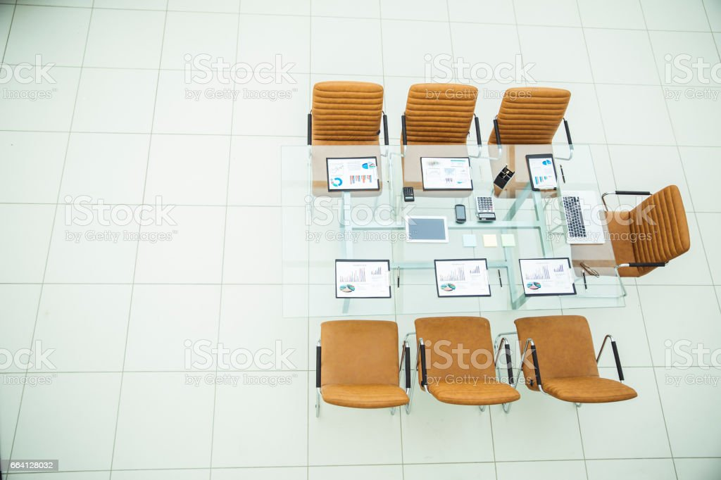 chairs and Desk with documents and laptop for negotiations with business partners foto stock royalty-free