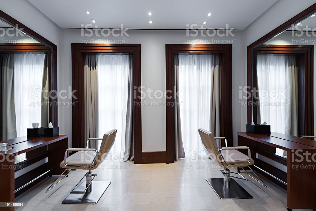 Chairs and mirrors in modern hairdressing stock photo