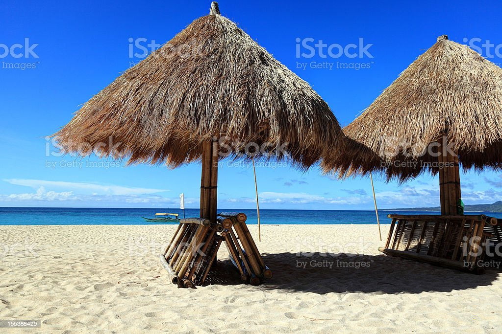Chairs and parasol on tropical beach royalty-free stock photo