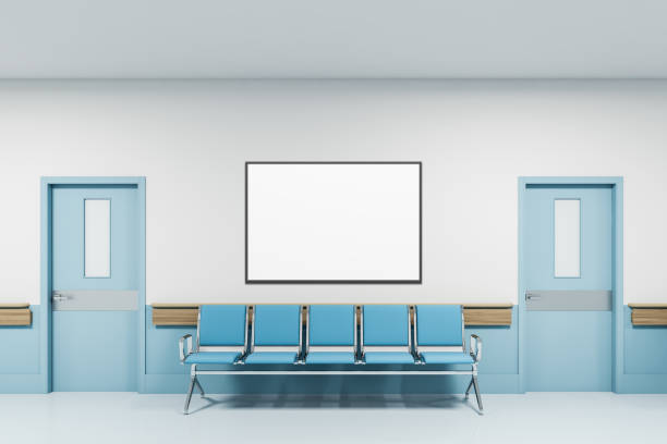 Chairs and poster in empty hospital hall