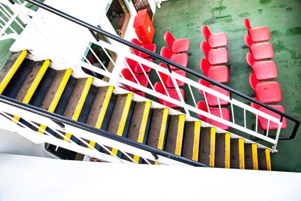 sillas y escaleras en un barco stock photo