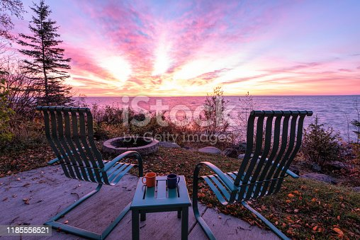 876420064istockphoto Chairs and Table over looking Lake Superior stock photo 1185556521
