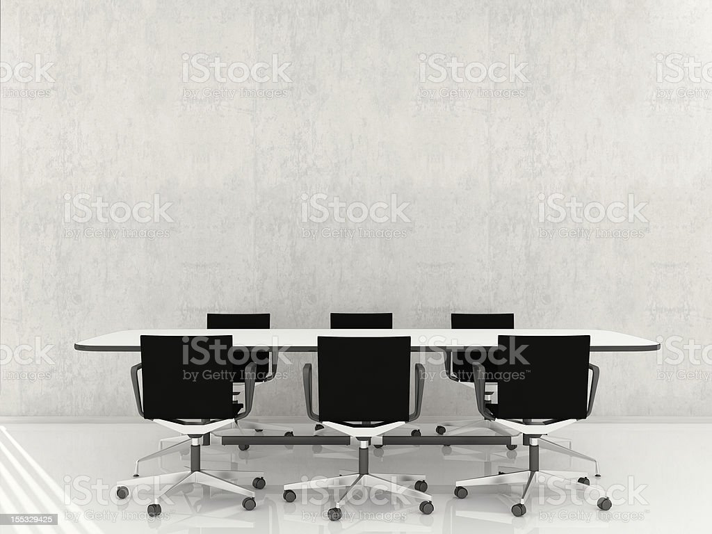 Chairs and table to face a blank wall royalty-free stock photo
