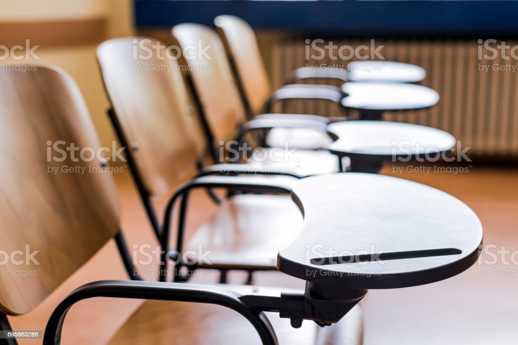 Chairs and tables in a campus classroom stock photo