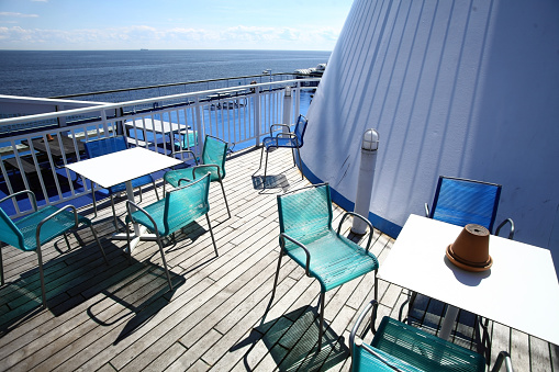 Chairs and tables on a ferry deck