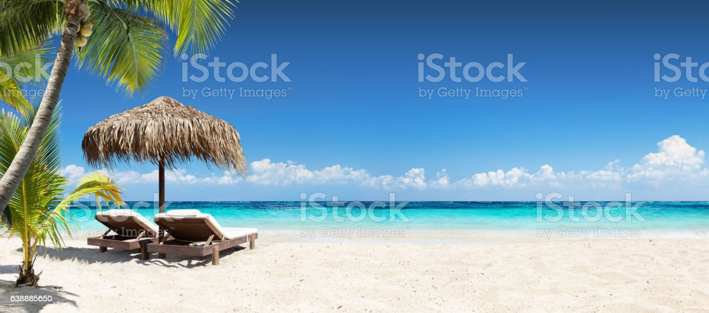 Chairs And Umbrella In Coral Beach - Tropical Resort Banner stock photo