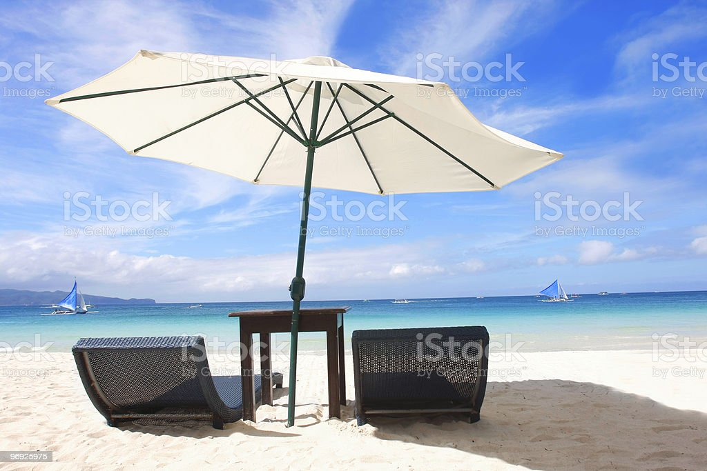 chairs and umbrella on sand beach royalty-free stock photo
