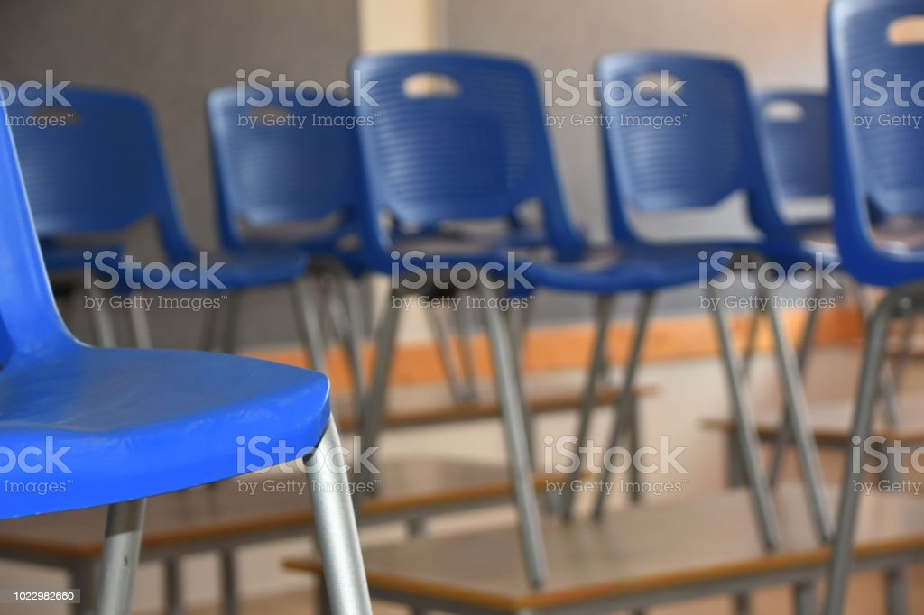 Chairs are arranged on the table in class
