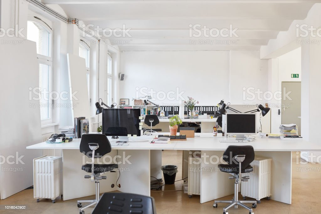 Chairs arranged at desk in office stock photo