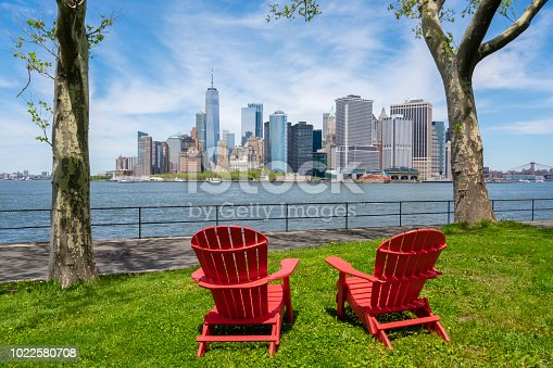 Chairs on Governors Island facing the skyline at Lowr Manhattan in New York City