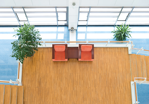 Chairs for rest in modern office building.