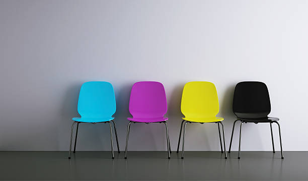 chairs in a row cmyk chairs in a row illustrating cmyk colours. cmyk stock pictures, royalty-free photos & images