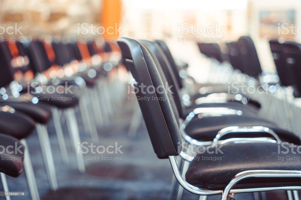 Row of chairs in boardroom.