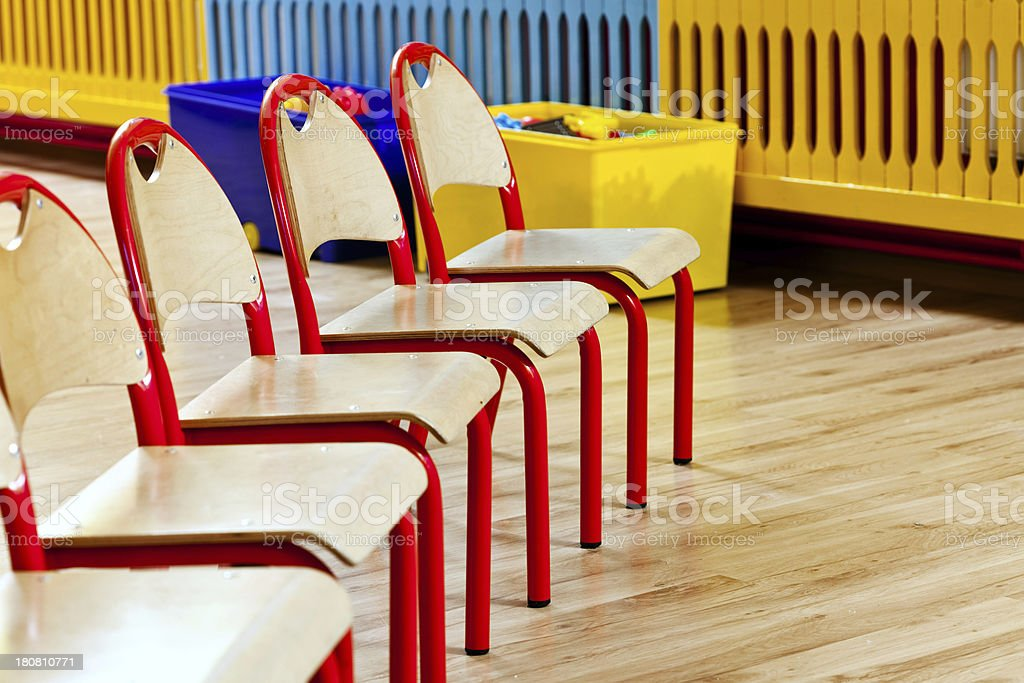 Chairs in a row Five chairs in a row in a nursery school.  Chair Stock Photo