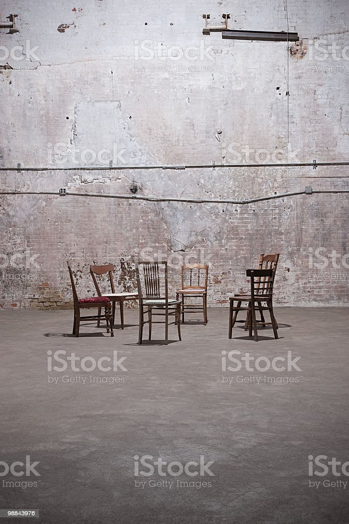 Chairs in empty warehouse royalty-free stock photo