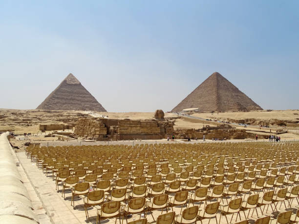 Chairs in front of the pyramids in Egypt stock photo
