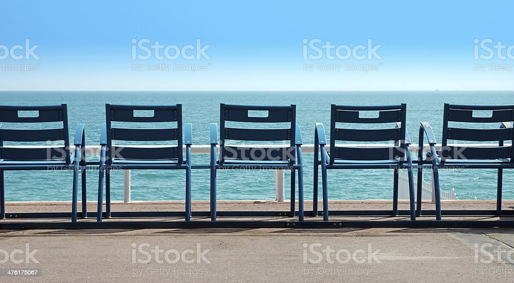 Chairs in front of the sea stock photo