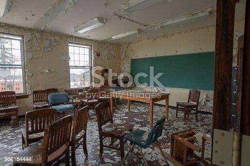 istock Chairs inside abandoned classroom 956184444