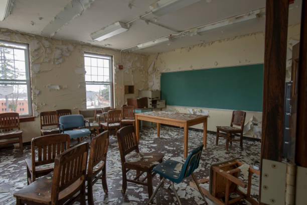 Chairs inside abandoned classroom stock photo