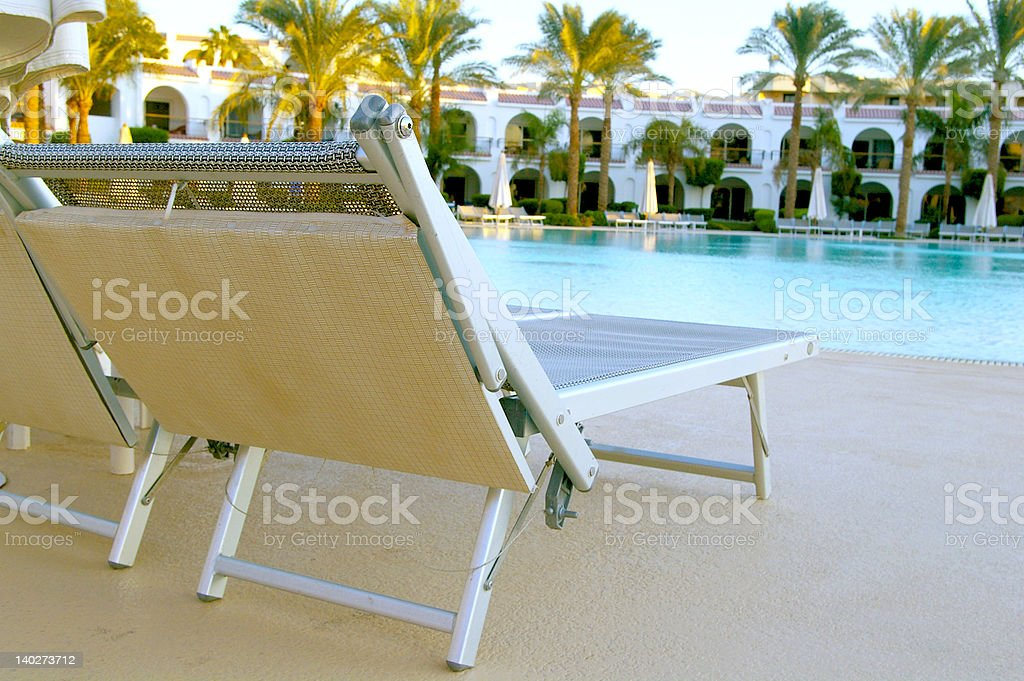Chairs near a pool royalty-free stock photo
