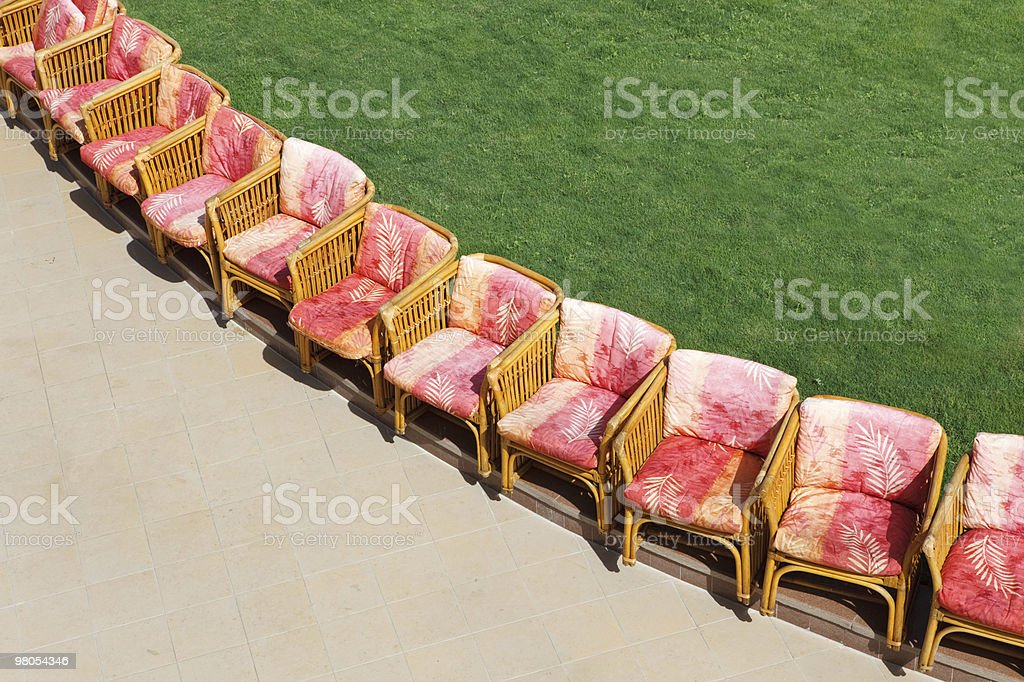 Chairs near lawn royalty-free stock photo