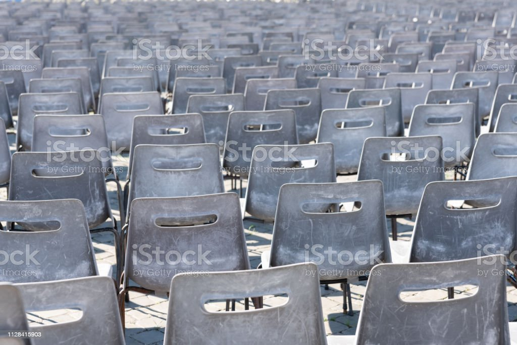 Lots of chairs prepaed for an open air event